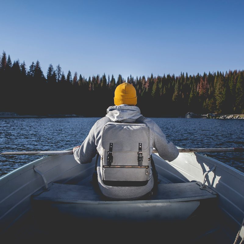 picnic time bar backpack man in boat