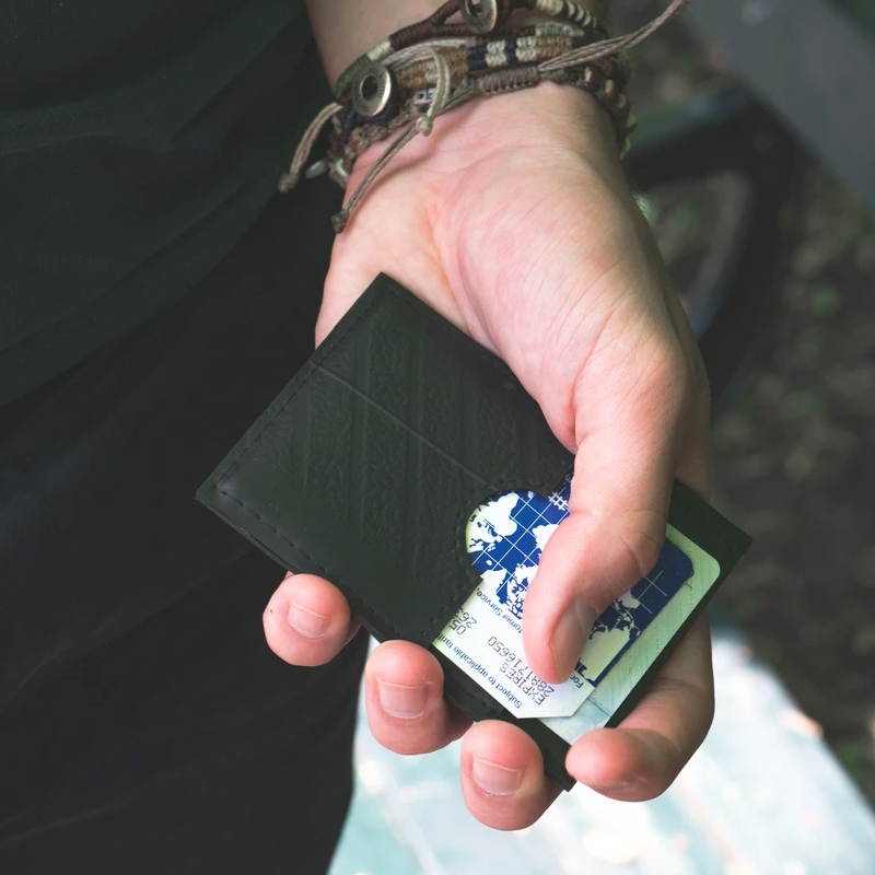 global goods partners card wallet in hand