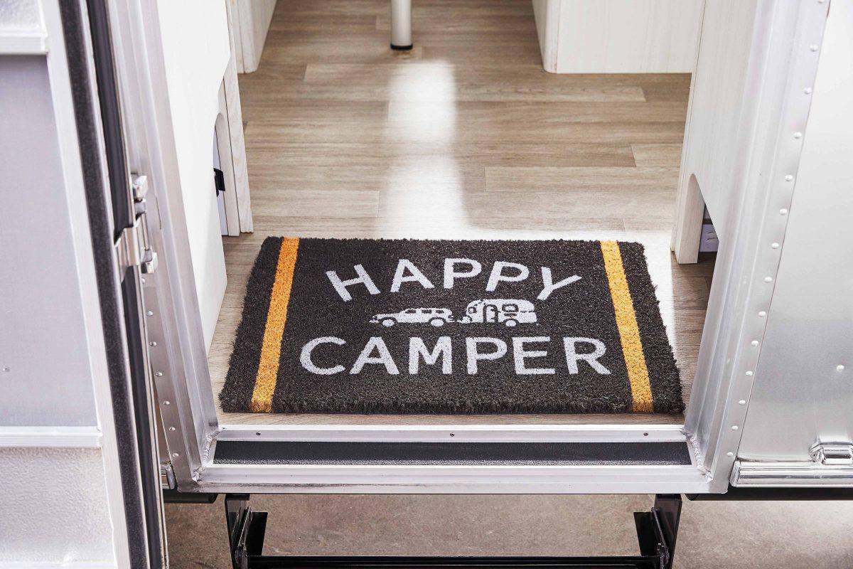 Airstream + Pottery Barn FloorMat Happy Camper
