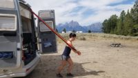 A woman working out with resistance bands on her Airstream