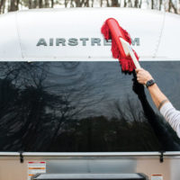 Shell of an Airstream being cleaned with a California Car Duster
