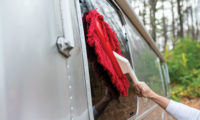California Car Duster being used to clean the shell of an Airstream