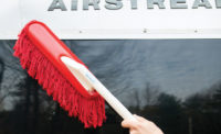 California Car Duster Cleaning off the outside of an Airstream