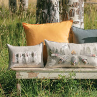 Display if pillows in a grassy field
