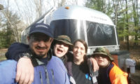 Family with their Airstream in the background