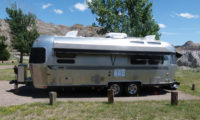 Airstream trailer parked at a campground